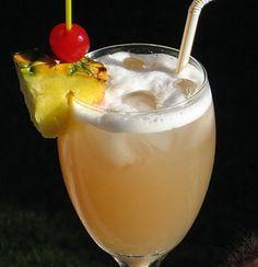 Malibu Barbie ~ 1.5 oz. Malibu Coconut Rum, 1.5 oz. Pineapple Rum, 5 oz. Pineapple Juice, Pineapple wedge and Cherry for garnish