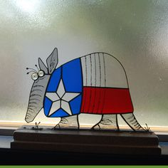 Texas Armadillo Stained glass details are black Reusche stain mixed with clove oil and applied with a quill pen measures 8.5 inches x 13 inches in the base he measures 10 inches x 15 inches