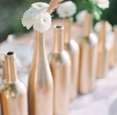 Wine bottles and gold spray paint