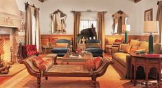 In the living room of a Beverly Hills home decorated by Madeline Stuart, a 19th-century Anglo-Indian daybed stands opposite a pair of Madeline Stuart slipper chairs upholstered in Gilles Linen Velvet by Travers; the rug was custom made by Aga John, and the vintage Anglo-Indian copper elephant is from J. F. Chen.   - ELLEDecor.com