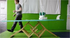 Sewing table made from two broken chairs and an old surfboard.  Redesigned by Robert Kalin, founder of ETSY.
