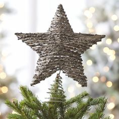 Rattan Star Tree Topper  | Crate and Barrel.  Or really any pretty tree topper, we don't have one :)