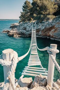 Rope bridge over a cliff in Punta Christo, Pula, Croatia - Cool rope bridge (Svjetionik bridge) over a cliff in Punta Christo. You definitely need to go there - Beach Aesthetic, Travel Aesthetic, Adventure Aesthetic, Nature Photography, Travel Photography, Image Photography, Landscape Photography, Destination Voyage, Croatia Travel