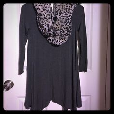 Very chic gray cozy tunic This very cute gray tunic is perfect for this cold weather. The material is very soft, stretchy and loose. Can be worn with some very cute faux leather leggins, some combat boots and throw on a cute scarf and you're ready to hit the night Phanuel Tops Tunics