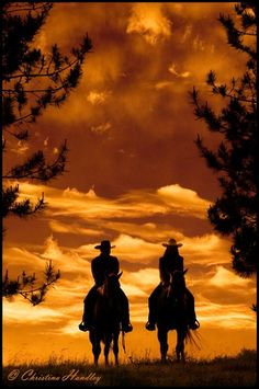 That sunset makes you many to be a cowboy.