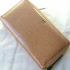 Kate Spade zipper wallet rosegold glitterbug Brand new never worn.  Kate Spade Neda zipper wallet in patent leather rose gold glitterbug color Very cute and perfect for spring summer time. 2 bill folds 12 cards slots and 1 zip compartment. Zipper wallet style with gold kate spade logo.  I put a high price so that I can drop it for ship discount. kate spade Bags Wallets