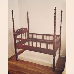 Antique mahogany spindle bed / baby crib