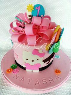 Hello Kitty.Fondant cake. Fondant bow. Happy 1st birthday.