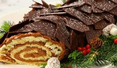 Dark Chocolate Buche de Noel - Recipes - Best Recipes Ever - This classic cake is light and airy, and it's filled with fluffy chocolate icing. This dessert is an impressive finish to any holiday dinner. Chocolate Bark, Chocolate Icing, Holiday Baking, Christmas Desserts, Christmas Eve, Classic Cake, Xmas Food, Best Food Ever, Holiday Dinner