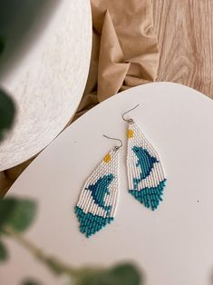 Ocean fringe collection! Dolphin earrings are really bright, cartoony and joyful. Blue dolphin and sea waves, feel yourself on the beach 🏖 These exclusive dolphin earrings were designed and beaded by me from scratch. You can be sure that your earrings have an exclusive original design 💫 Prom Earrings, Fringe Earrings, Beaded Earrings, Beaded Jewelry, Jewellery, Bead Embroidery Jewelry, Beaded Embroidery, Brick Stitch Earrings, Sea Waves