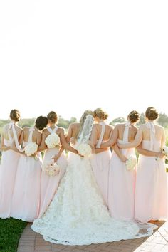 Bride and her bridesmaids in blush pink dresses. Love this photo idea!