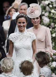 The Duchess of Cambridge was by her sister's side all day. Not only did she help straighten her dress train before the ceremony, she kept the children under control and stood loyally behind her after the nuptials
