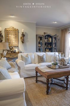 Living room with soft gray walls (SW Agreeable Gray) & warm toned accents - Vintage Interiors