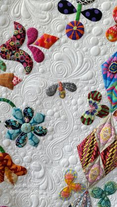 Harriot by Sue Cody for Material Obsession. Applique work by Beth and quilted by Judi Madsen