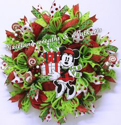 Have yourself a Minnie Mouse Christmas. The kids will love this one! This wreath was designed on a 24 red metallic work wreath with red metallic deco mesh. The wooden Minnie Mouse measures 14 x 9 and is attached securely to the base of the wreath. There are 4 different ribbons: 2.5 white with red metallic polka dots, 2.5 lime green with metallic polka dots. 1.5 emerald green with red metallic polka dots, and 1.5 red with emerald green metallic polka dots. All ribbons are wired and may be…