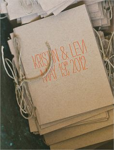 Love the kraft paper programs tied with twine~ except with prettier font on the front with maybe a woodsy wreath decoration to match the invites
