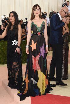 Dakota Johnsonin a Gucci dress and Norman Silverman Diamonds bracelets