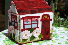Fabric fold up doll house with flowers