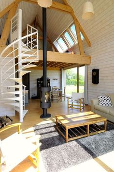 Design living room and mezzanine upstairs / salon design et mezzanine en haut | More photos http://petitlien.fr/maisonarchi