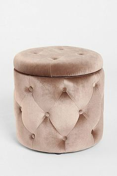 """""""Ava"""" tufted round storage ottoman in pale pink from Urban Outfitters ($110)."""