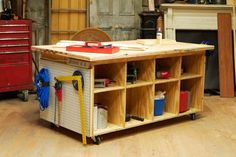 This Old House has step-by-step plans for this awesome unit that works as storage AND a workspace (they promise it's an easy project – try it and let us know, will you?).