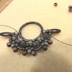 Component made around a ring base.  Nice step by step ~ Seed Bead Tutorials