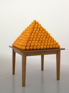 Peter Coffin  Untitled (Orange Pyramid),2007  table and oranges, installation dimensions variable