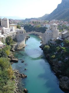 The famous bridge in Mostar, Bosnia spanning the river Neretva.  - Ruined 1994 by HVO, during the 'Yoguslavian' war. Rebuild by donations.