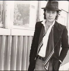 Robbie Robertson of The Band. Nice style. His face kind of resembles Eddie Van Halen here actually.