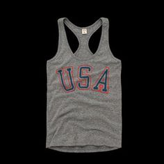 Show off your USA pride in our women's racerback tank top. Perfect whether you're rooting for the team or cooking out for the 4th!  • WOMEN'S STYLE• HEATHERED GREY, POLY/COTTON/RAYON BLEND• RACERBACK TANK TOP• PREWASHED• SLIMMER FIT• SOFT SCREENPRINT AT CHEST• MADE IN USA