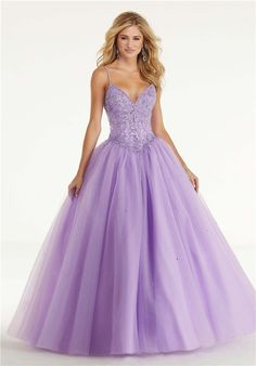 Morilee Prom 45013 Princess ballgown with a crystal beaded bodice and long sparkling tulle skirt. The dress is completed with a v-neckline and corseted back. Princess Prom Dresses, Princess Ball Gowns, Princes Dress, Wedding Dresses, Prom Dress Stores, Beaded Prom Dress, Designer Prom Dresses, Sweet 16 Dresses, Mori Lee
