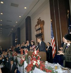 President Kennedy stands behind the lectern at the Fort Worth Chamber of Commerce breakfast at the Hotel Texas in Fort Worth