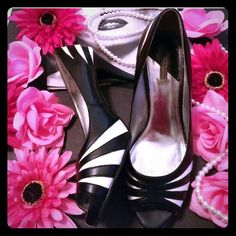 Cute black and white peep toes Daisy Fuentes size 8. There is a spot on the left foot(2nd pic), you might be able to get it off. Cute black and white 3 inch peep toes. Clothes and purse also for sale! Thanks for looking!! Daisy Fuentes Shoes Heels