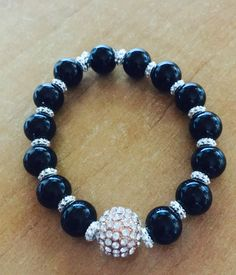 A personal favourite from my Etsy shop https://www.etsy.com/uk/listing/465692475/bead-bracelet-black-rose-gold-handmade