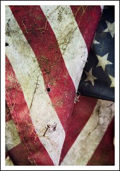 a little tattered and torn, and little dirt too, but the stars and stripes still wave true!