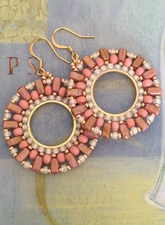 Beautiful beadwork earrings made with rose, cream and bright metallic gold seed beads. Each bead is individually hand sewn and expertly woven to make