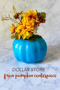 Decorate for fall on a budget with this Dollar Store craft! Simply paint a styrofoam pumpkin whatever color you would like, and then add your favorite faux flowers! Easy + will last for years to come!