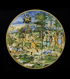 Dish with the Story of Erysichthon, with arms of Scheuffelin  Urbino, c. 1560  26.6 cm (diameter); cm (diameter)  tin-glazed earthenware (maiolica)  The composition is taken from a woodcut in Le Trasformationi di M Lodovico Dolce, an Italian verse adaptation of Metamorphoses, first published in Venice in 1553. Fortnum believed the plate to be a product of the workshop of Girolamo dalle Gabicce in Pesaro.