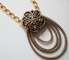 Golden Zipper Necklace with Large Flower Vintage Button. $29.00, via Etsy.