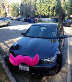 Totally saw a bright blue sedan driving along with one of these today in Boston. A giant dude was driving to boot! They are LYFT cars! A sort of mercenary taxi service.