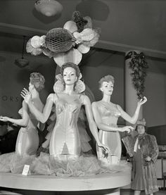 "December 1942. ""New York. Corset display at R.H. Macy & Co. department store…"