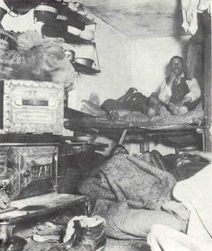 Immigrants had to live in and share small rooms which they called their home. The photo is of an NYC tenement for immgrants.
