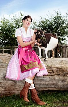 A darling baby goat and a beautiful pink dirndl, what's not to like? :) #goat #farm #cute #pink #dirndl #dress #folk #costume #German #clothing