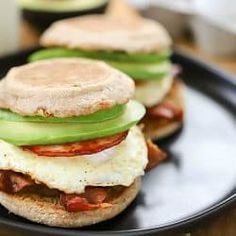 Start your morning off right with this Egg, Bacon and Avocado Breakfast Sandwich! A buttered whole wheat english muffin filled with crispy bacon, canadian bacon, fried egg and avocado. So yummy! Dinner Recipes For Kids, Healthy Dinner Recipes, Diet Recipes, Healthy Snacks, Cooking Recipes, Healthy Eats, Yummy Recipes, Breakfast Recipes, Avocado Breakfast