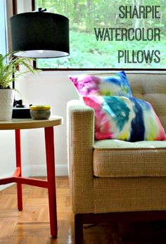 Make Watercolor-Inspired Pillows...With a Sharpie! (http://blog.hgtv.com/design/2014/05/13/diy-sharpie-tie-dye-watercolor-pillows/?soc=Pinterest)