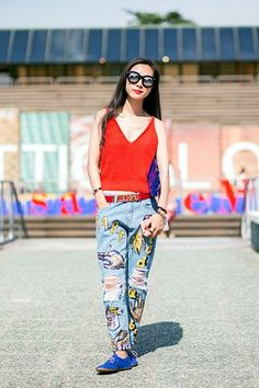 Those Moschino name belts are a huge trend, and help give a pair of fun pants a touch of structure. #refinery29 http://www.refinery29.com/belts-outfits#slide-1