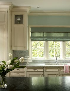 The kitchen and laundry wall colors are Sherwin Williams SW 6211 Rainwashed.