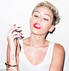 Miley Cyrus smoking a cigarette for a shoot for Terry Richardson