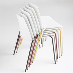 Unnia 1.1, stackable chairs with seats and backs that can be seperately colored to create your perfect design. Office, Hospitality, Interior, Design.