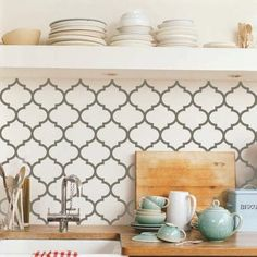 "Did you know that you can order custom vinyl patterns from uppercase living to create the look of a backsplash? You can order in your choice of over 50 colors and range of sizes from 6"" - 20"" sheets.  You can use the vinyl as the backsplash or as a stencil!  www.vinylwithfaith.com"